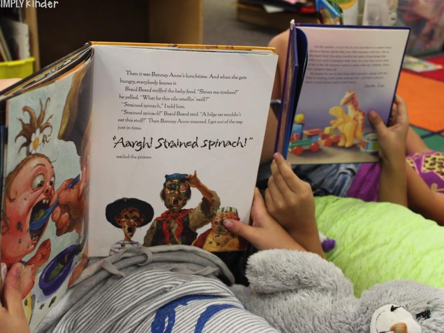 Students reading using their new keepsake pillowcases!